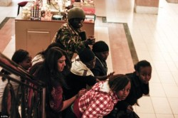 k54-A-soldier-directs-people-up-stairs-inside-the-Westgate-shopping-mall-after-a-shootout-in-Nairobi-Kenya.-450x300