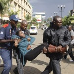k70-A-security-officer-helps-an-injured-woman-away-from-the-building-150x150